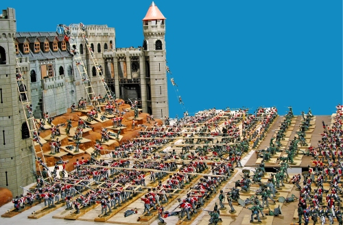 Plastic toy soldiers against Playmobil castle